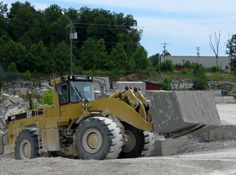 Loader Carrying a Limestone Block