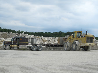 Loader Placing a Block on Trailer Bed